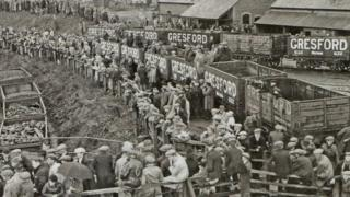 Crowds gathered to await news in the aftermath of the disaster