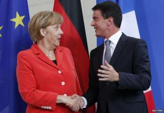 German Chancellor Angela Merkel with French PM Manuel Valls (22 Sept)