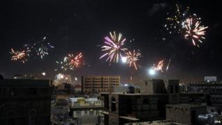 Shia Houthi rebels release fireworks to celebrate the ceasefire deal that was signed on 21 September, in Sanaa, Yemen, on 22 September 2014.
