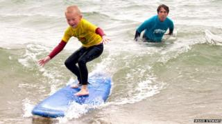 Eight-year-old Alfie surfing in Bournemouth