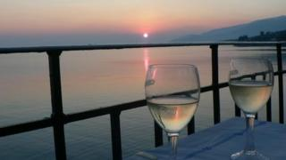 Wine glasses at sunset