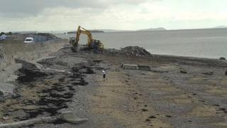 Rubble being cleared off the beach