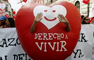"A protester with a ""Right to live"" heart during an anti-abortion protest in Madrid (21 Sept)"