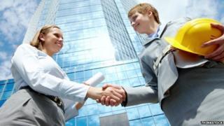 Professional women shake hands
