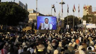 Supporters of Abdul Malik al-Houthi listen to his speech in Sanaa, 23 September 2014