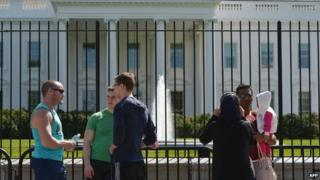 Tourists are seen in front of the White House in Washington, DC 23 September 2014