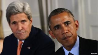 Picture of John Kerry and Barack Obama.