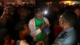 Protesters argue with a Ferguson sergeant who was trying to get them to disperse the area in Ferguson