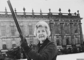 The Dowager Duchess of Devonshire outside Chatsworth House with a big gun