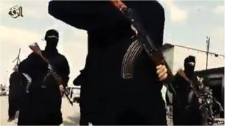 A screengrab from a video apparently showing armed Islamic State fighters