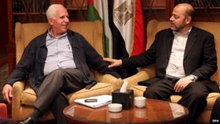 Member of Palestinian Fatah party, Azzam al-Ahmad (L), meets with Hamas politburo member Musa Abu Marzouk (R) at a hotel in Cairo, Egypt, 24 September 2014
