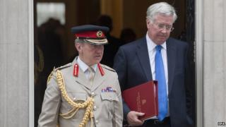 Chief of the Defence Staff General Sir Nicholas Houghton and Michael Fallon leaving Downing Street