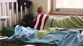 A Kenya woman in hospital being treated for complications after having an illegal abortion