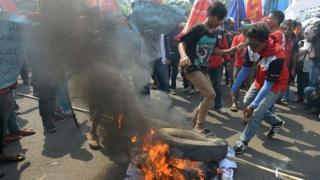 Protesters burn tyres outside parliament in Jakarta. 25 Sept 2014