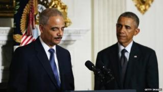 Attorney General Eric Holder announces his resignation, as US President Barack Obama looks on, 25 September 2014