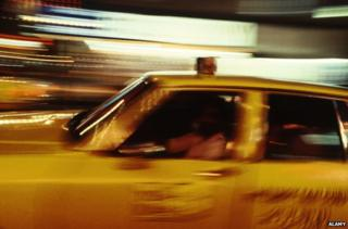 Blurred picture of 1970s NY cab driving at night