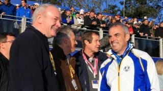Martin McGuinness and Peter Robinson with Europe team captain Paul McGinley