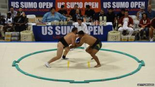 Sumo wrestlers fight during their bout at the US Sumo Open in Long Beach on 20 September, 2014
