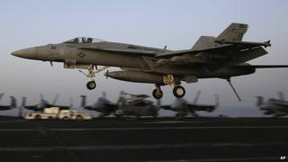 Fighter jet coming from Iraq lands on US aircraft carrier USS George HW Bush, in the Gulf. 10 Aug 2014