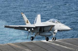 An F/A-18F Super Hornet lands aboard the aircraft carrier USS George HW Bush in the Gulf, 23 September