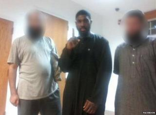 Alton Nolen makes a one-finger gesture at the mosque