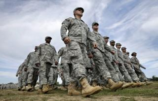 New Jersey National Guard troops march as they pass in review during the New Jersey National Guard's annual Military Review