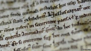 Close up of part of the text of Magna Carta in Salisbury Cathedral