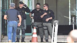 Police special forces are deployed at a hotel where an unidentified man is threatening a hotel employee on 29 September, 2014.