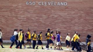 Students at Emma Hutchinson School in Atlanta leave after the day's classes 13 July 2011