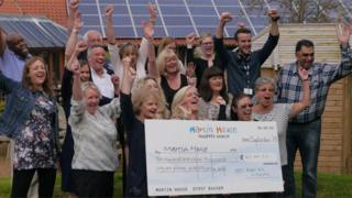 Fundraisers with large cheque