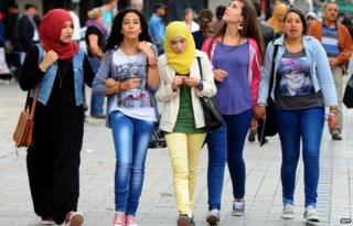 Tunisians walking in central Tunis, Tunisia - November 2013