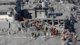 Rescue workers search for missing bodies after Mount Ontake eruption on 28 Sept