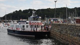 Passengers leaving the Herm Travel Trident at the Cambridge Steps in St Peter Port Harbour, Guernsey