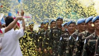 Peacekeeping troops from the Philippines return to a hero's welcome on 1 Oct.