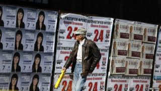 Man walks past election posters in Plovdiv