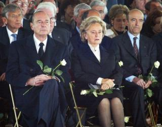 Jacques Chirac (left) with his wife Bernadette and Alan Juppe at a memorial ceremony for shooting victims in Nanterre, 2 April 2002
