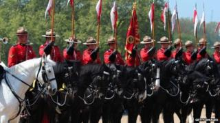 Members of the Royal Canadian Mounted Police parade with British Guards (Far L) on Horse Guards Parade in central London, on May 23, 2012,