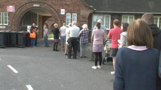 Voters queue at the Flint hospital beds referendum