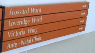 Sign in the Princess Elizabeth Hospital pointing to the Loveridge Ward, which is the maternity ward