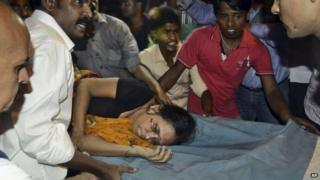 An injured woman is carried on a stretcher to a hospital for treatment in Patna, India, on 3 October 2014