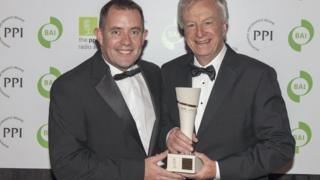 Seamus McKee Gold News Broadcaster of the Year winner receives his award from Sean Ashmore