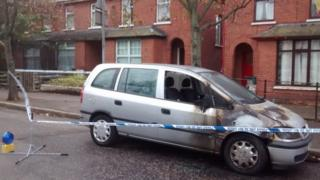 The car was set alight and extensively damaged in the overnight attack in Ulsterville Avenue