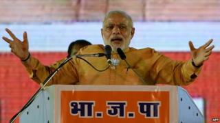 Indian Prime Minister and Bharatiya Janata Party leader Narendra Modi gestures as he speaks during a public rally ahead of the Maharashtra state election, in Mumbai on October 4, 2014