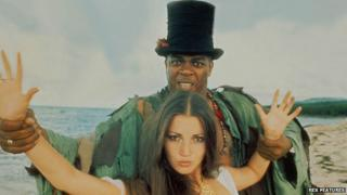 Geoffrey Holder with Jane Seymour in a promotional image for Live and Let Die