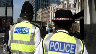 Two officers from City of London police, in florescent yellow jackets
