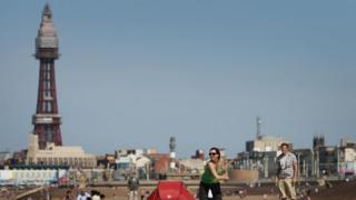 People on the beach with Blackpool Tower in the background