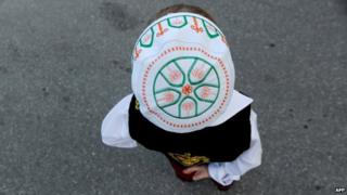 A child at a mosque in Kosovo