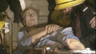 Norman Tebbit being removed from rubble