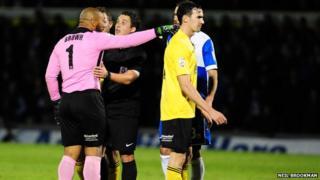 Jason Brown talks to referee