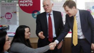 Norman Lamb (left) pictured with Nick Clegg who is shaking hands with a woman